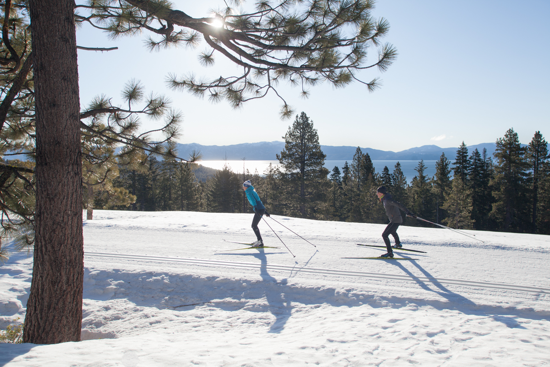 Two skiers with view of Lake Tahoe