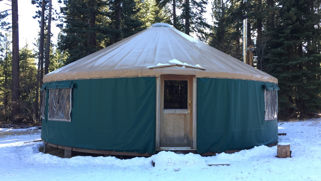 Winter Discovery Center Yurt with snow on the ground.